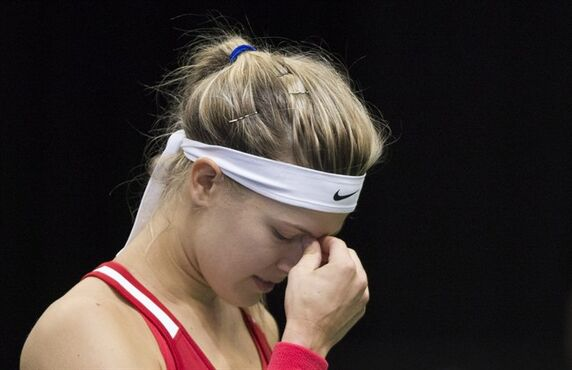 Canada's Eugenie Bouchard reacts during her Federal Cup tennis match against Romania's Alexandra Dulgheru in Montreal, Saturday, April 18, 2015. THE CANADIAN PRESS/Graham Hughes