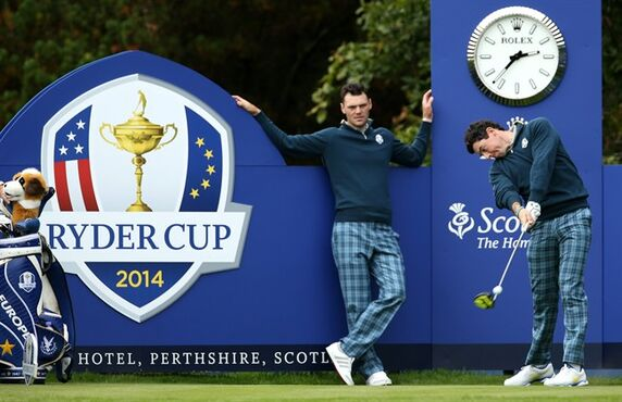 Europe's Rory McIlroy plays a shot off the 15th tee as Martin Kaymer looks on during a practice round ahead of the Ryder Cup golf tournament at Gleneagles, Scotland, Tuesday, Sept. 23, 2014. (AP Photo/Peter Morrison)