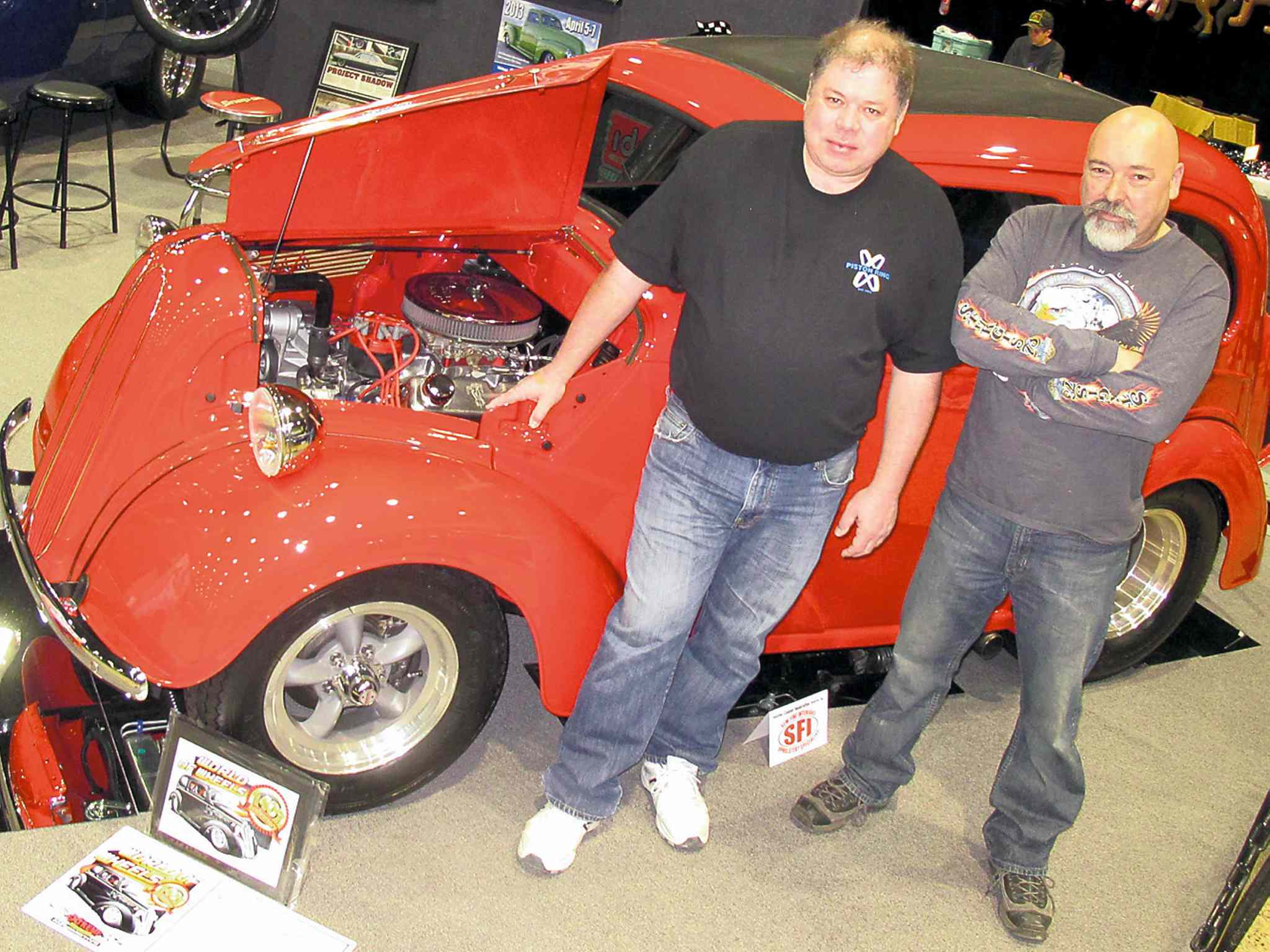 Bob Donnelly, left, with his 1949 Anglia. The car was restored by Dale Loewen, right, and the crew at SanDale Fabrication.