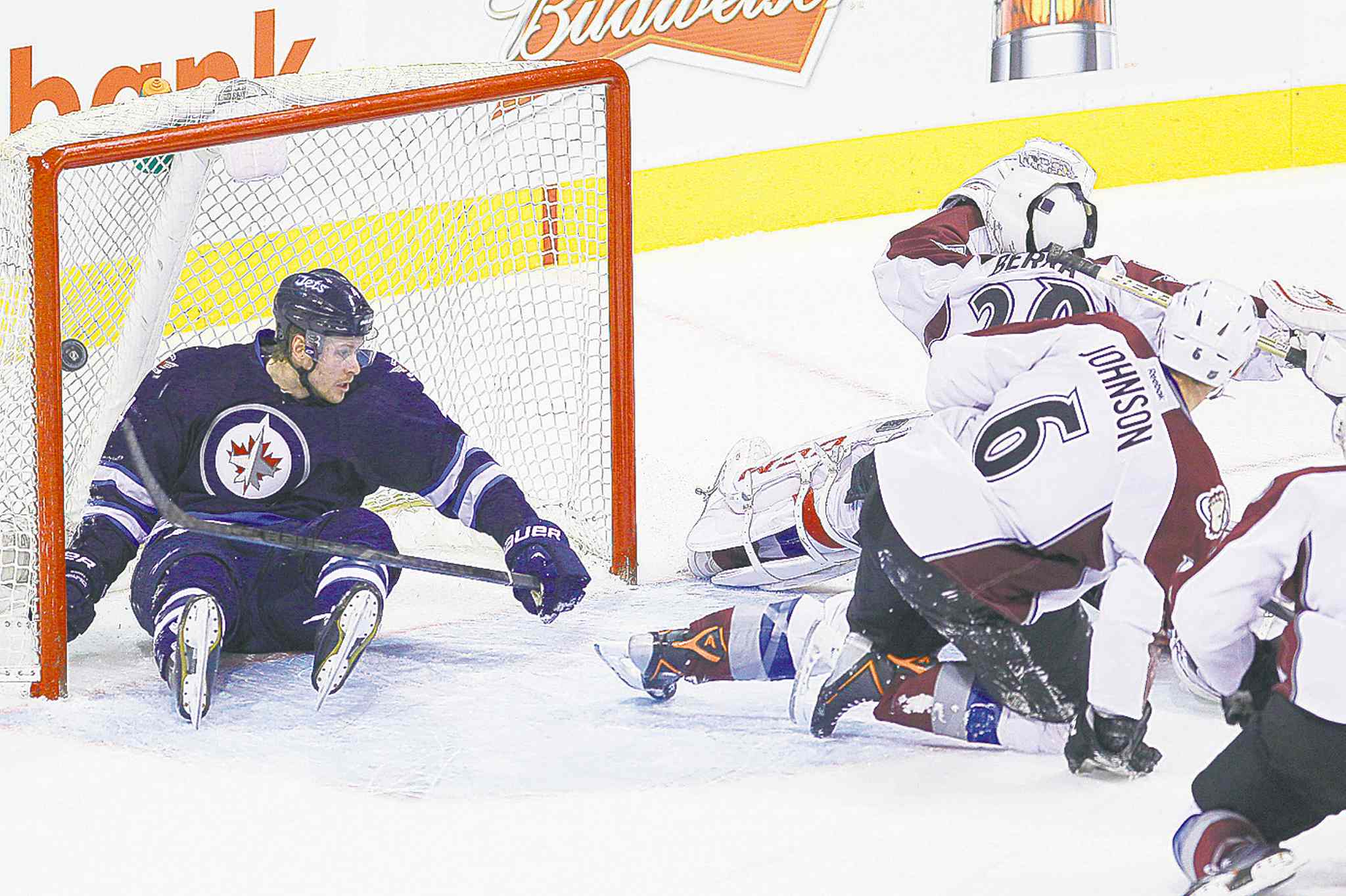 Winnipeg blue-liner Paul Postma crashes into the net just as Blake Wheeler scores the OT winner Wednesday night.