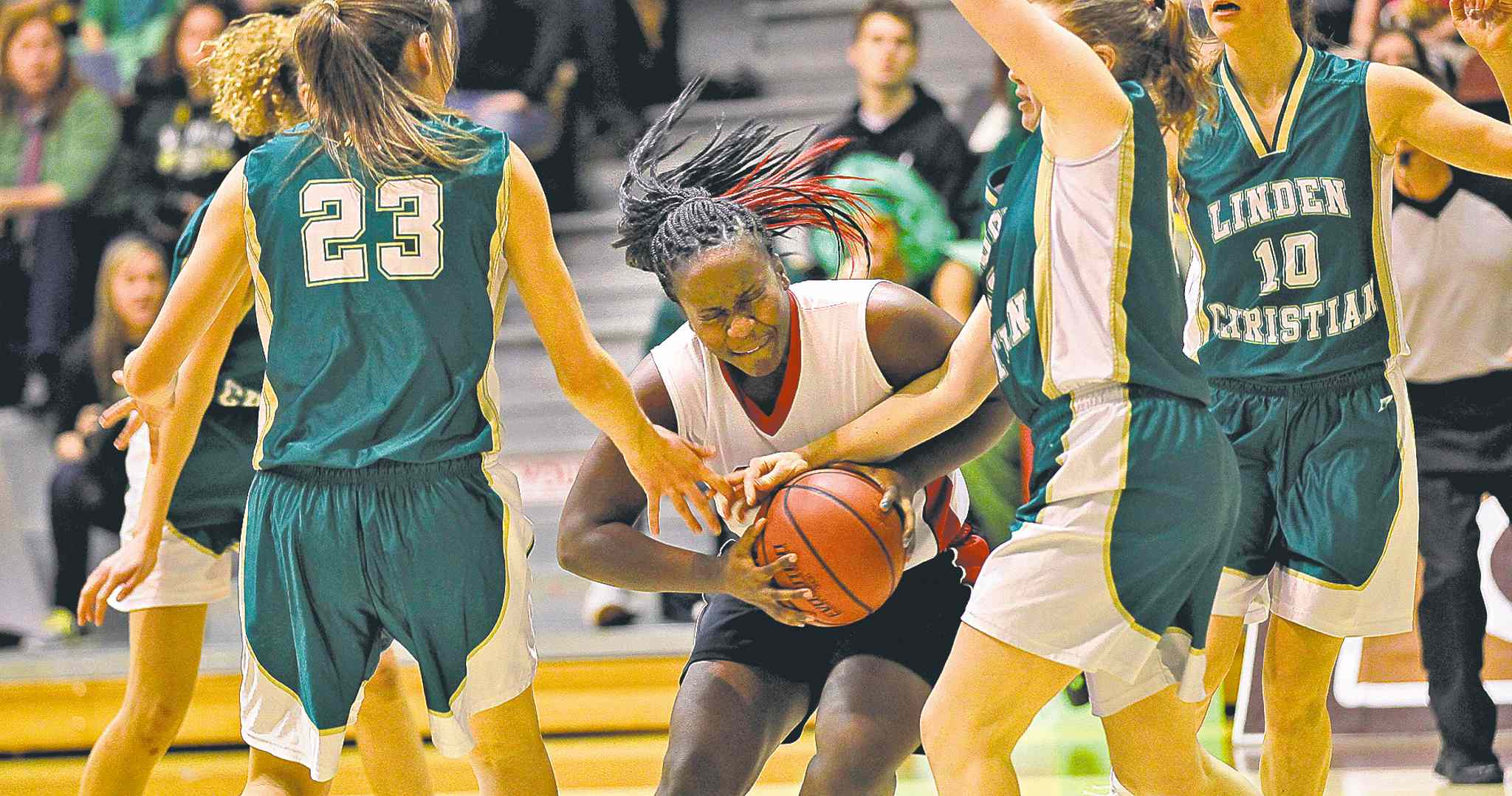 Sisler's Kyanna Giles drives through the Linden Christian defence during semifinal action Thursday night. Kyanna Giles finished the night with 30 points.