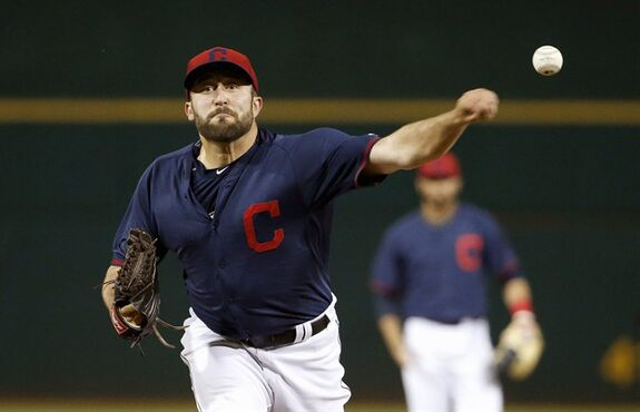 Cleveland Indians' T.J. House warms up prior to pitching in the second inning of a spring training baseball game against the San Francisco Giants on Tuesday, March 24, 2015, in Goodyear, Ariz. (AP Photo/Ross D. Franklin)