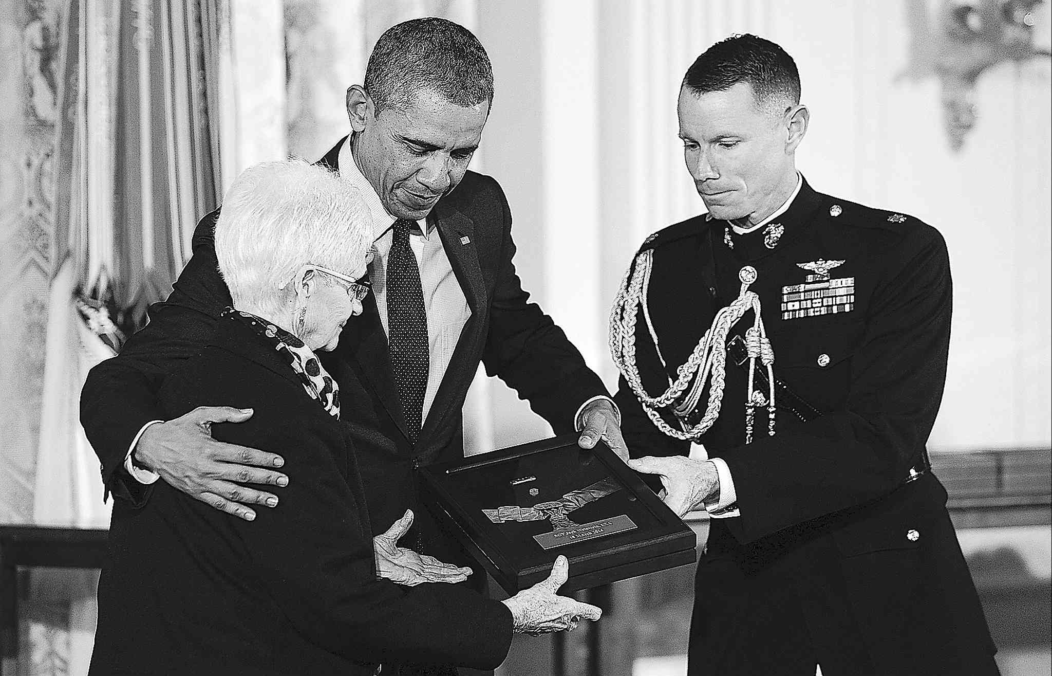 Nancy Weinstein accepts the Medal of Honor for her husband former Army Sgt. Jack Weinstein from President Barack Obama on  March 18 in Washington.