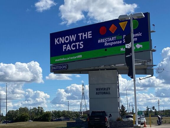A billboard showing the Manitoba government's reworked advertising campaign following a rise in COVID-19 cases in recent weeks.