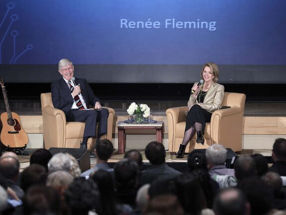 NIH/Image Caffeine Photograph</p><p>World-renowned opera singer Renée Fleming (right) delivers her Music and the Mind presentation with Dr. Francis Collins, the director of the U.S. National Institutes of Health.</p>