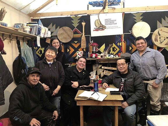 Niigaan Sinclair, centre, with elders and counsellors at the Arctic Indigenous Wellness Foundation (AIWF) free breakfast in a traditional camp.