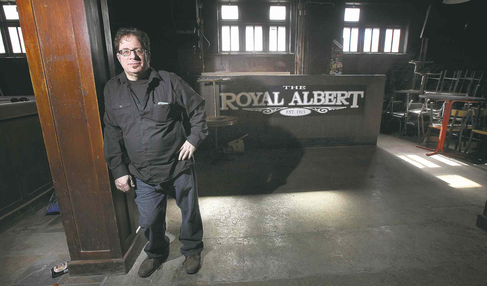 Martin Boroditsky, a.k.a. Marty Gold, stands in the closed bar at the Royal Albert Arms hotel. Gold has been hired to play the role of the cleanup guy.