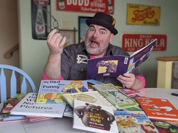 Christie Steffensen photo</p><p>Big Daddy Tazz is reading story books online using Facebook Live to entertain kids stuck at home during the coronavirus scare.</p>