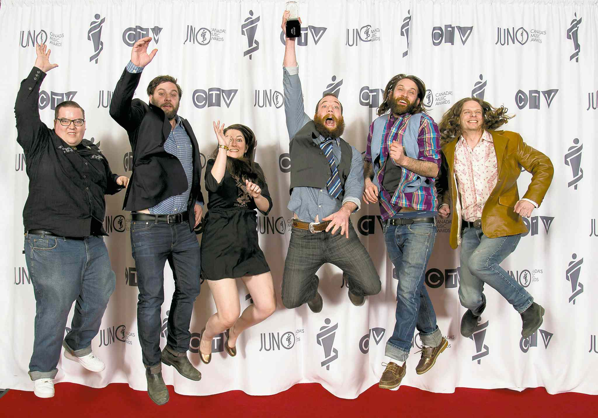 The Strumbellas celebrate their Juno Award for Roots and Traditional Album of the Year.