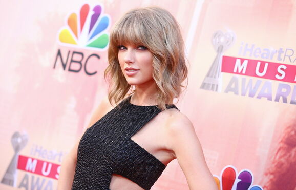 Taylor Swift arrives at the iHeartRadio Music Awards at the Shrine Auditorium on Sunday in Los Angeles. Swift is nominated for artist of the year.
