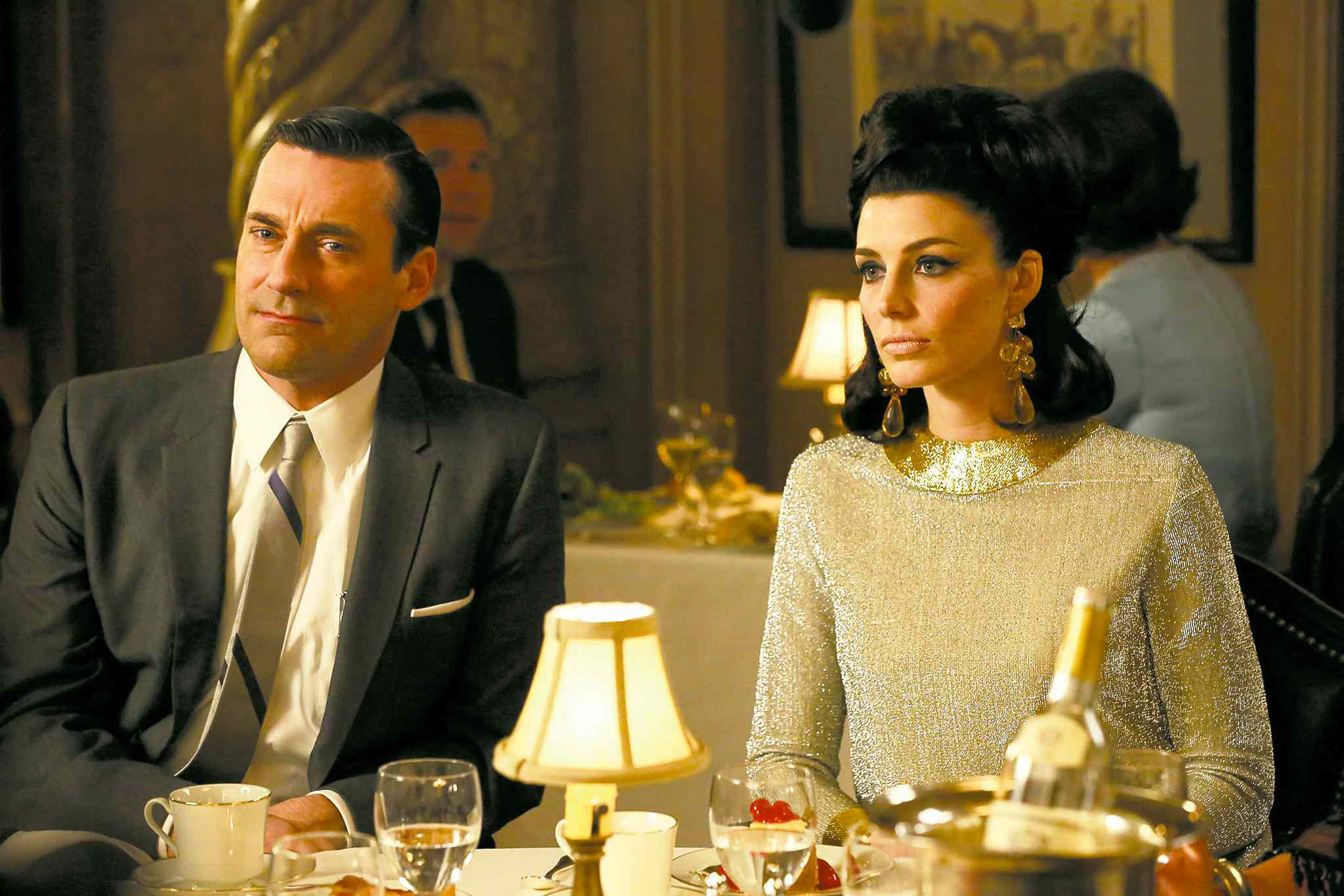 This TV publicity image released by AMC shows Jon Hamm as Don Draper, left, and Jessica Paré as Megan Draper in a scene from