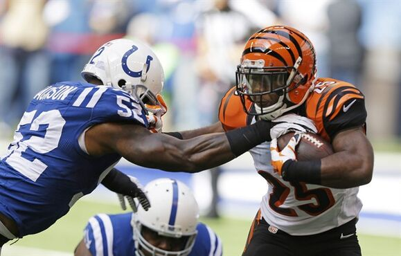 Cincinnati Bengals running back Giovani Bernard (25) is tackled by Indianapolis Colts' D'Qwell Jackson during the first half of an NFL football game Sunday, Oct. 19, 2014, in Indianapolis. (AP Photo/Michael Conroy)
