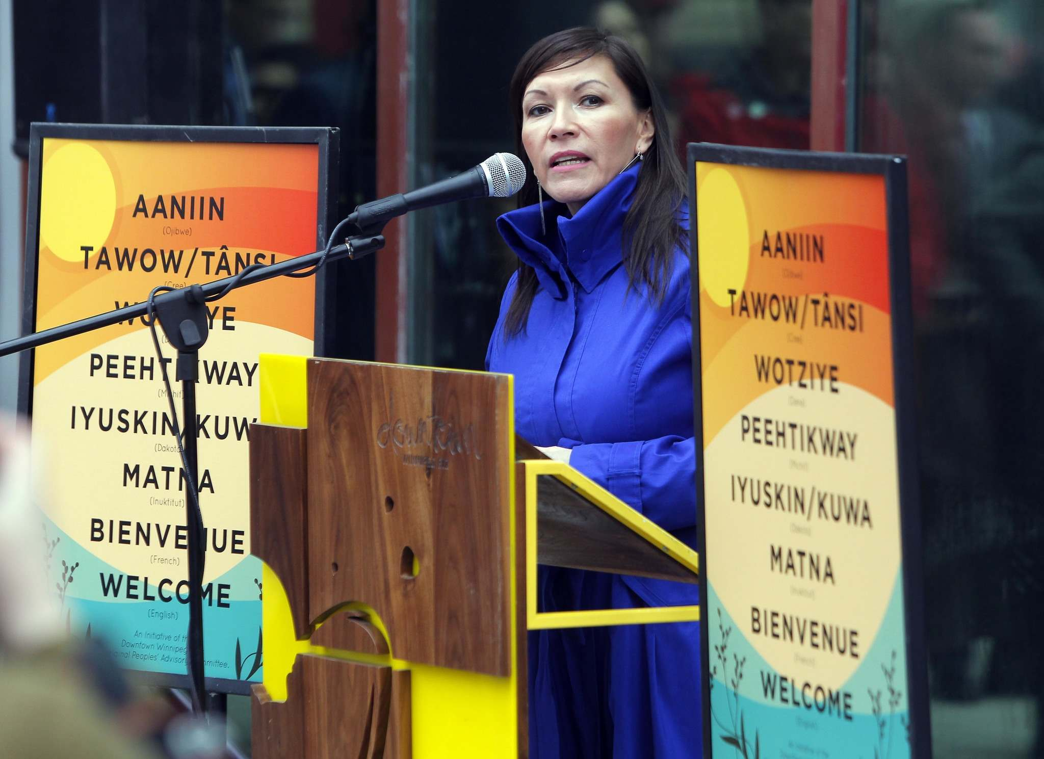 BORIS MINKEVICH / WINNIPEG FREE PRESS</p><p>Manito Ahbee Exec. Director Lisa Meeches helps launch new aboriginal-language signs that will be put up at downtown businesses. </p>