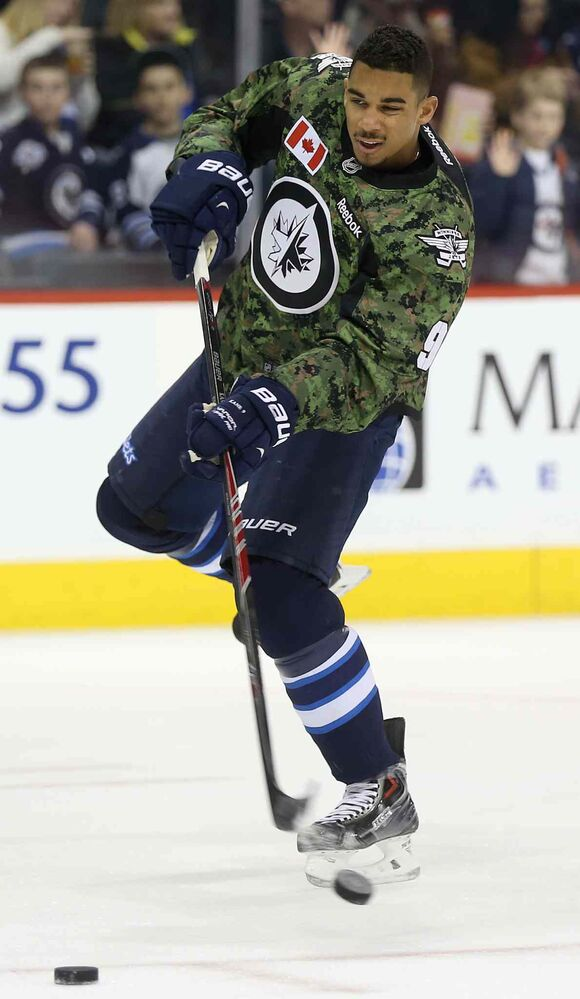 Winnipeg Jets' Evander Kane (9)  fires a shot during warmup while wearing a camouflage jersey on Military Appreciation day prior to the game against the Ottawa Senators Saturday