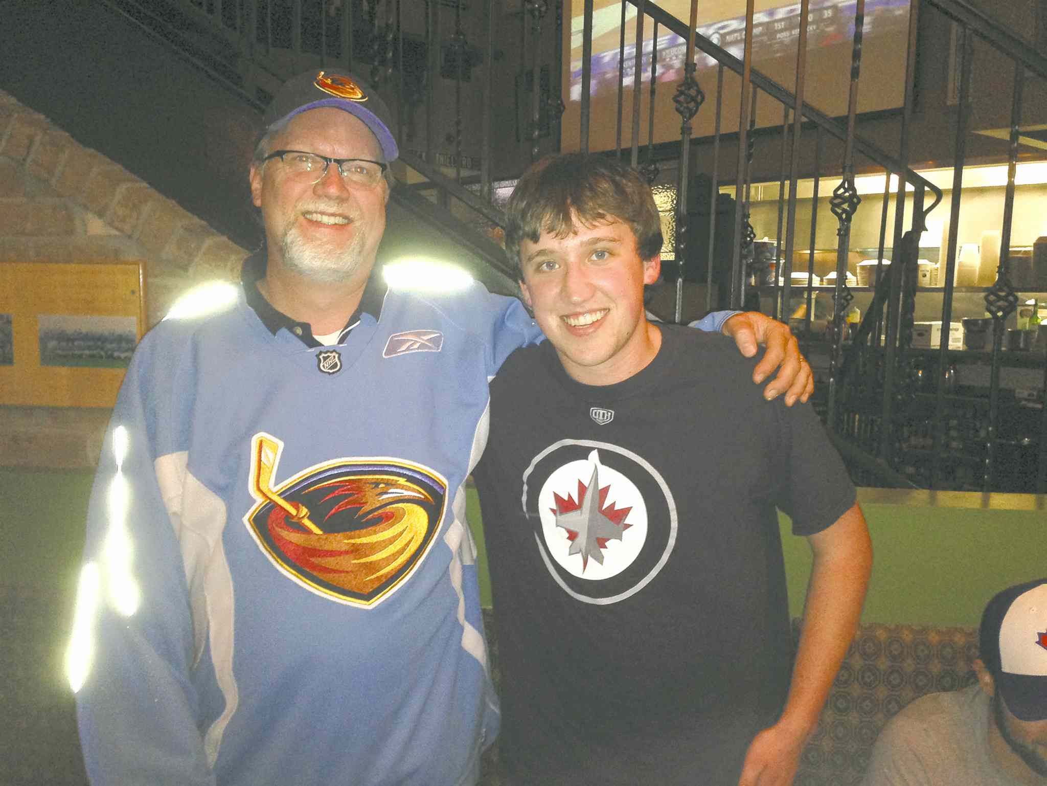 Atlanta resident Todd Cormack is the proud owner of a Thrashers jersey, while Luke Dixon prefers Jets garb.