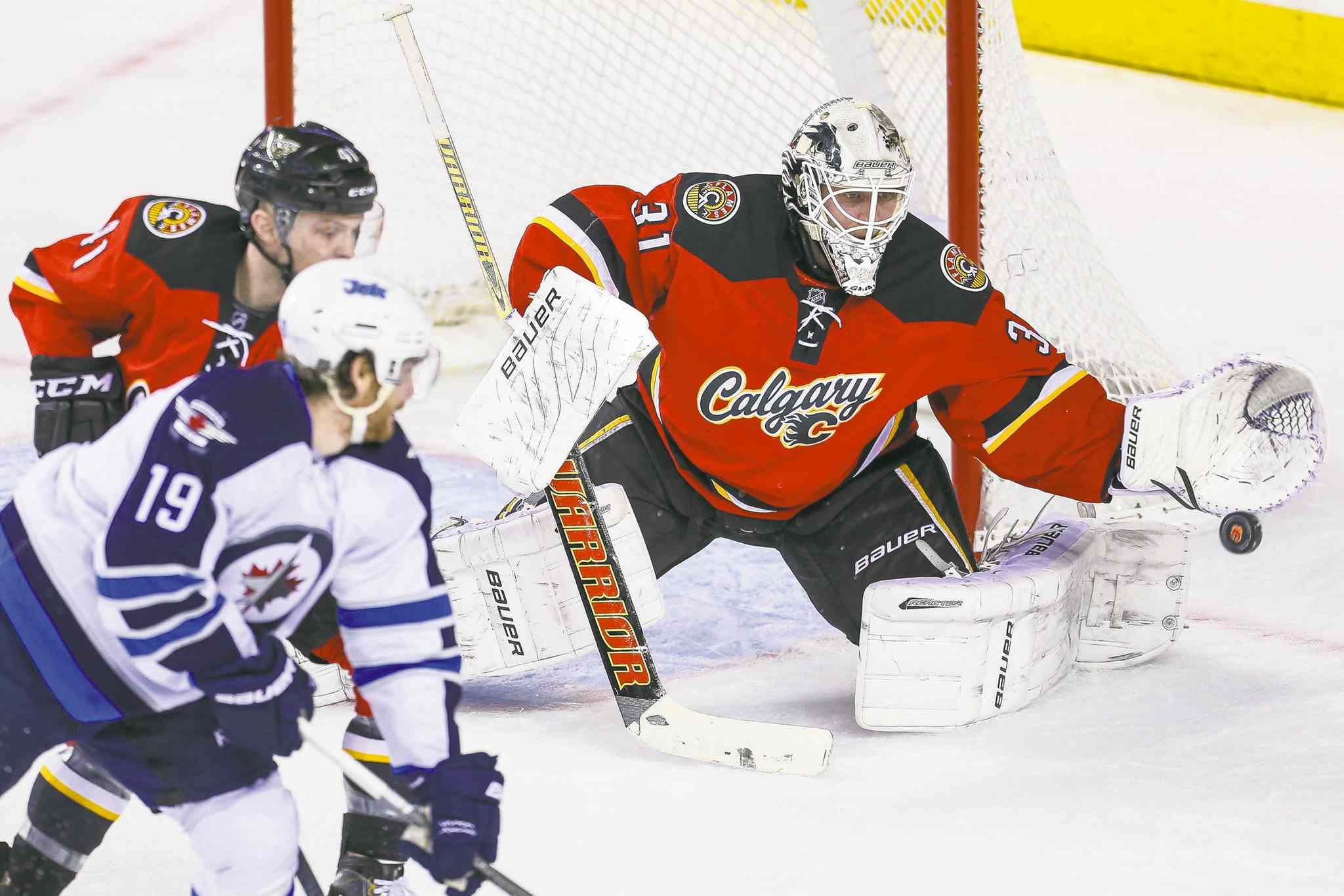 Sergei Belski / USA TODAY sportsCalgary Flames goalie Karri Ramo stymies Winnipeg Jets centre Jim Slater during first-period action on Friday night in Calgary. The game wrapped up the Jets� season.