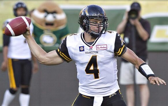 Hamilton Tiger-Cats quarterback Zach Collaros (4) makes the throw against the Edmonton Eskimos during first half action in Edmonton on July 4, 2014. Collaros will get the start at quarterback Monday afternoon when the Hamilton Tiger-Cats host the Toronto Arogonauts in the first game at new Tim Hortons Field. Collaros returns after missing the last four games with a concussion suffered in a 28-24 loss to the Edmonton Eskimos on July 4. THE CANADIAN PRESS/Jason Franson