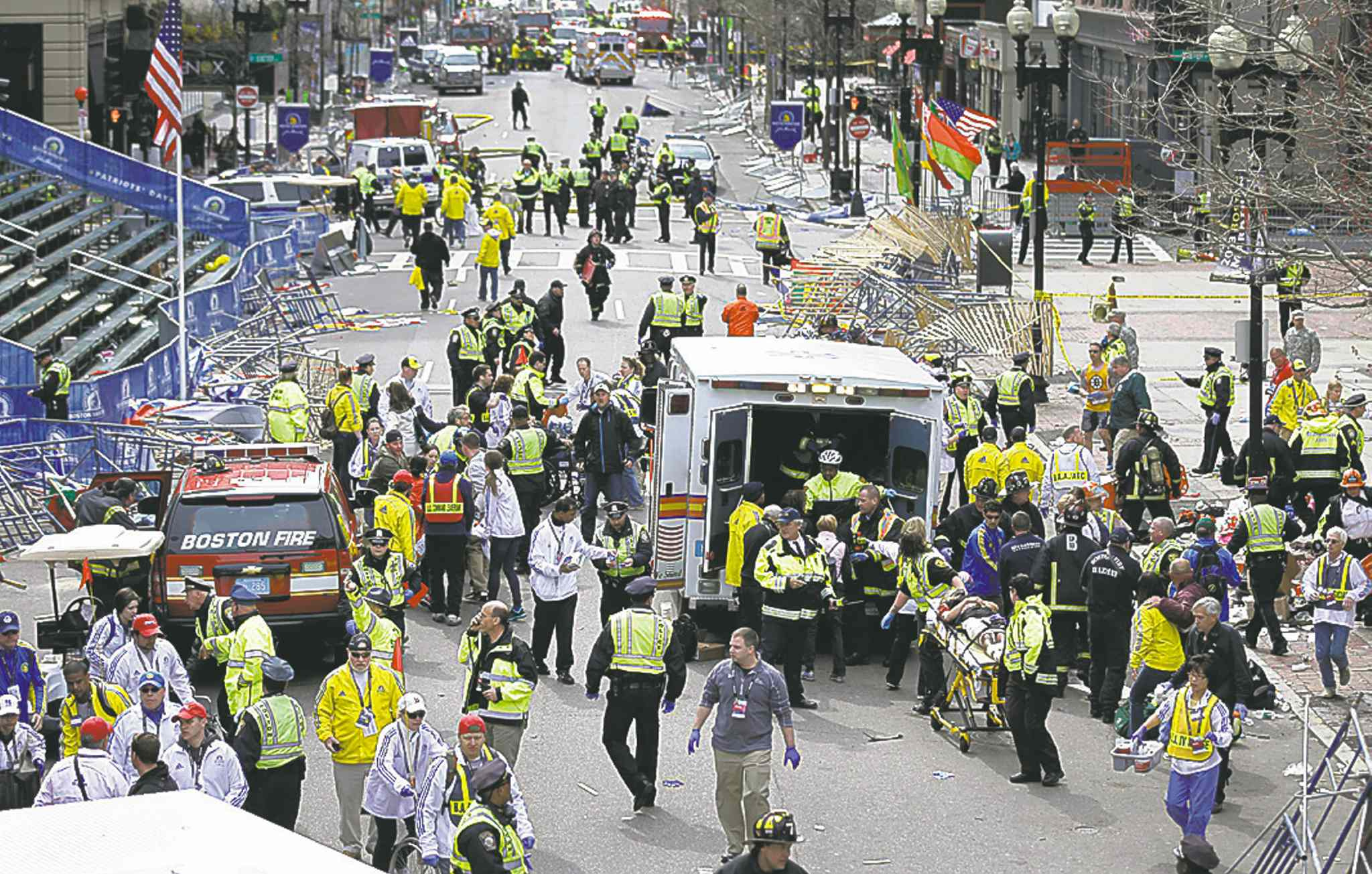 Emergency workers scramble to the aid of bombing victims near the finish line in 2013.