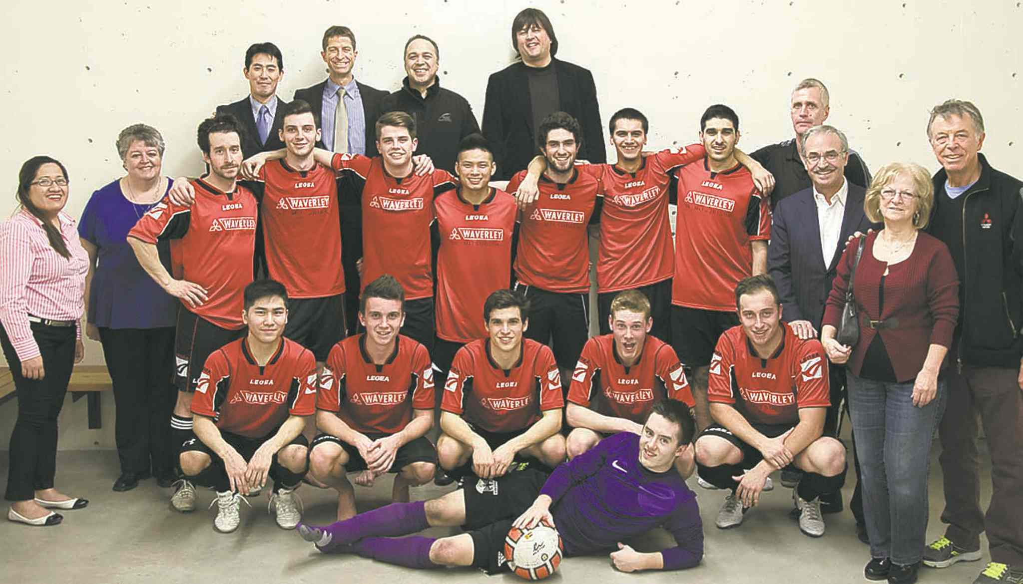 Waverley Mitsubishi's men's soccer team, with (top left)  Mitsubishi Canada President Kenichiro Yamamoto, Waverley Mitsubishi President Rino Attardo, Service Operations Manager and Parts Manager Kirk Christodoulides and Robert Maskiew; 2nd row: Waverley Mitsubishi administrative assistant Lee Holgado and Controller Denise Gustafson, Head coach Rudy Hartfiel, Vickar Automotive Group President Larry Vickar and parents of Rino Attardo, Al and Marie Attardo.