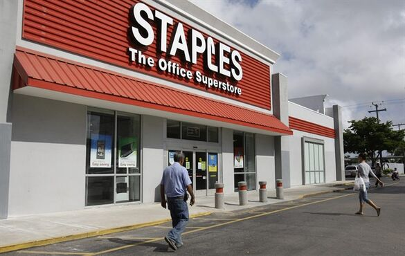 FILE - In this Tuesday, Nov. 15, 2011, file photo, customers enter Staples office supply store in Miami. Staples on Tuesday, Oct. 21, 2014 said it is looking into a potential credit card data breach and has been in touch with law enforcement officials about the issue. (AP Photo/ Lynne Sladky, File)