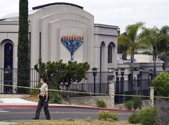 <p>Police tape surrounds the Chabad of Poway synagogue near San Diego.</p>