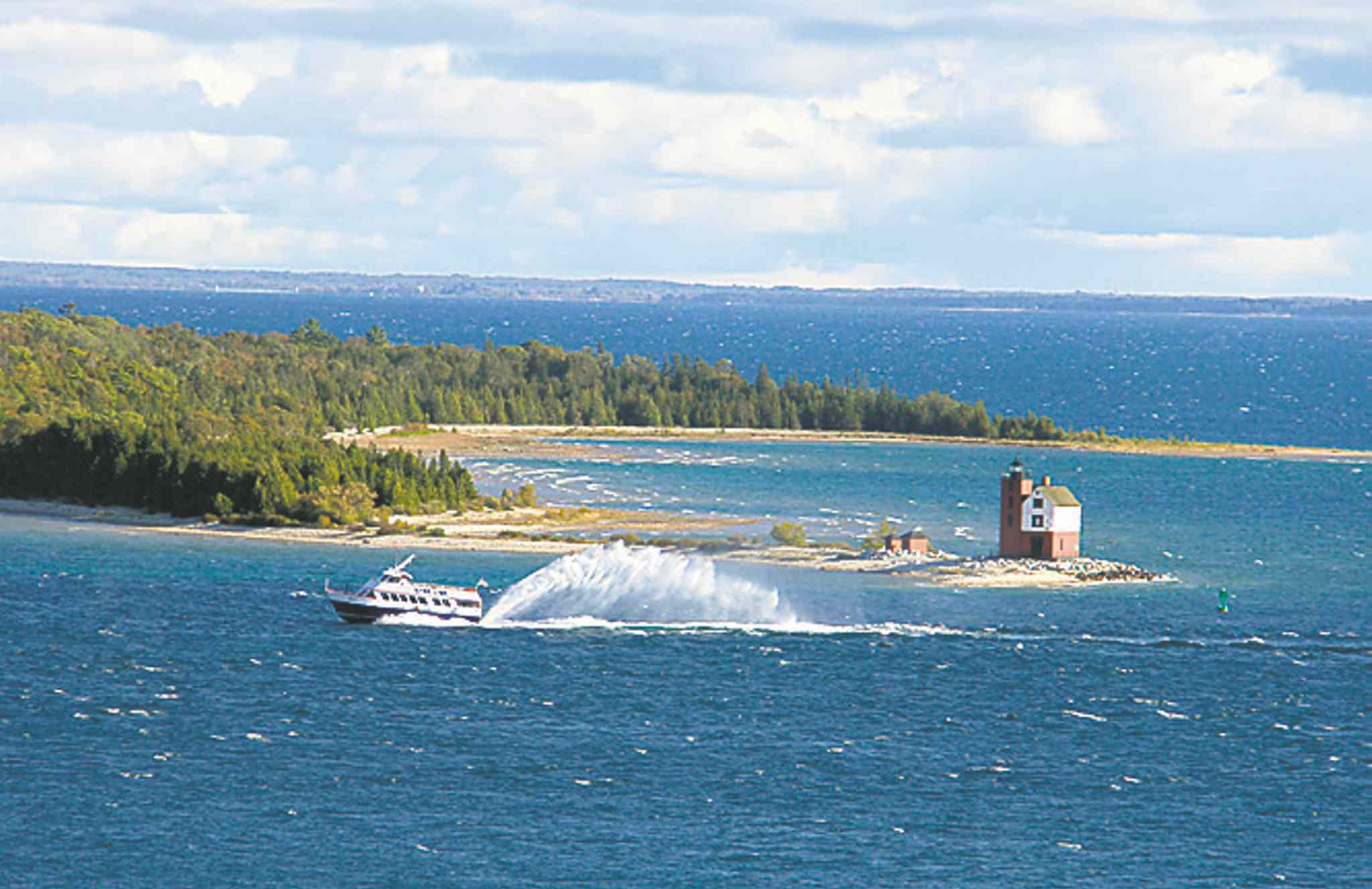 A ferry makes it way to  Mackinac Island.