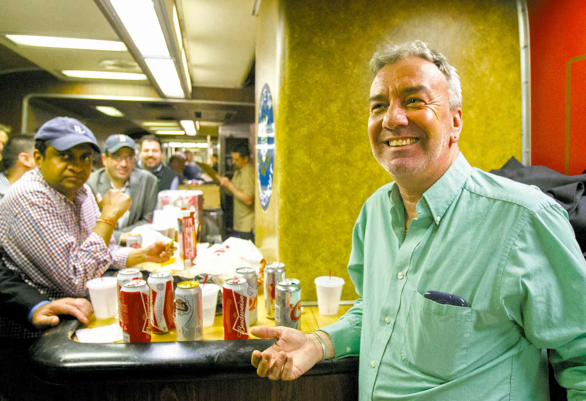 Mark DelMonte (right) of Wallingford, Conn., joins other commuters in the Connecticut-Manhattan train�s bar car on Friday, the last day of the bar�s existence.