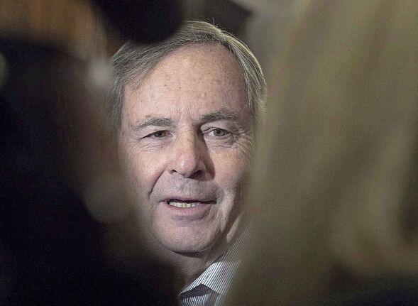 David MacNaughton, Canada's ambassador to the United States, talks with reporters before the morning session as the Liberal cabinet meets in St. John's, N.L. on Tuesday, Sept. 12, 2017. MacNaughton says predictions that NAFTA talks can be settled by the end of month are aspirational ??? even if American and Mexican officials were to reach an agreement today on complex auto sector issues. THE CANADIAN PRESS/Andrew Vaughan