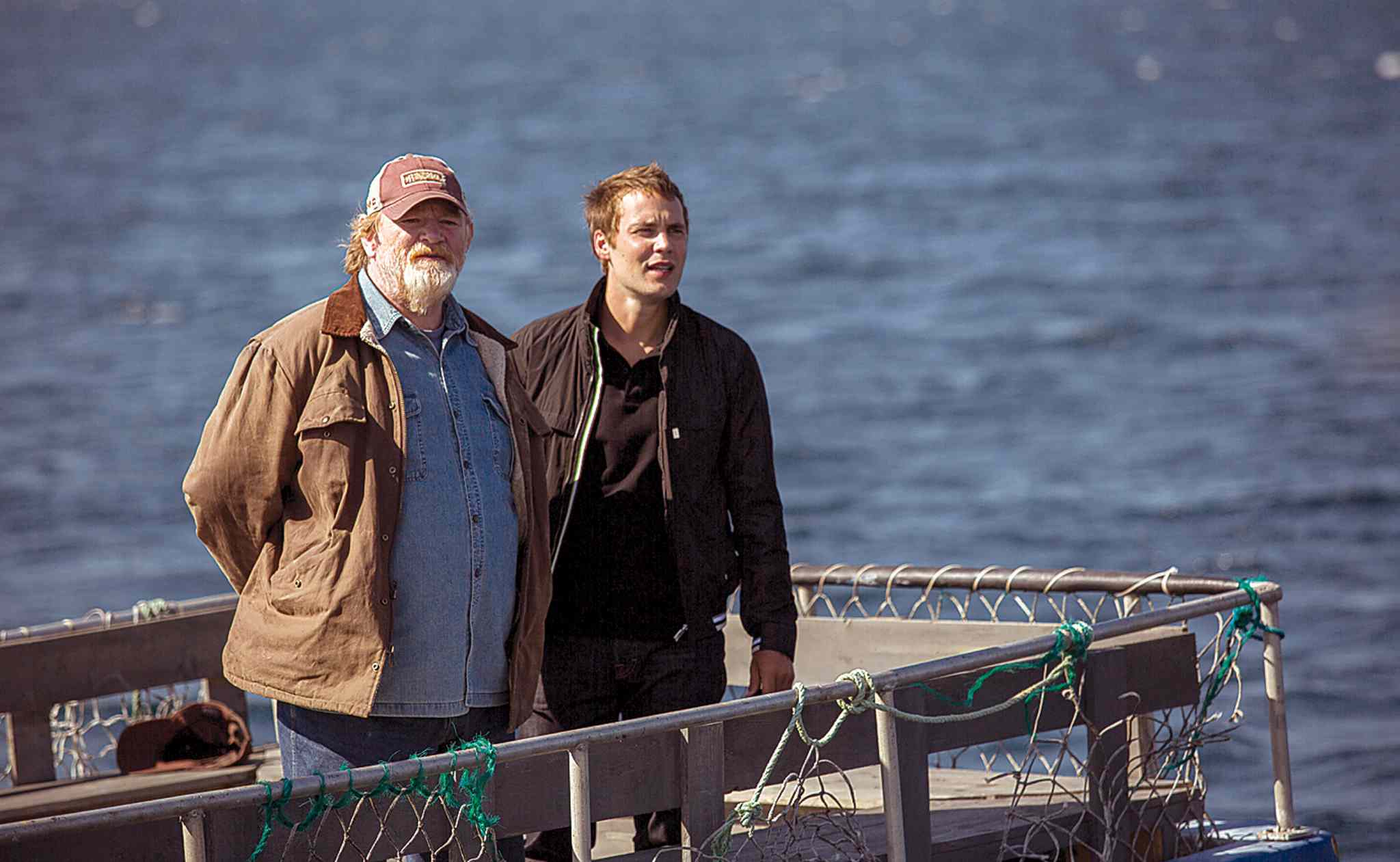 Gleeson (left) delivers the sales pitch to Kitsch in The Grand Seduction.