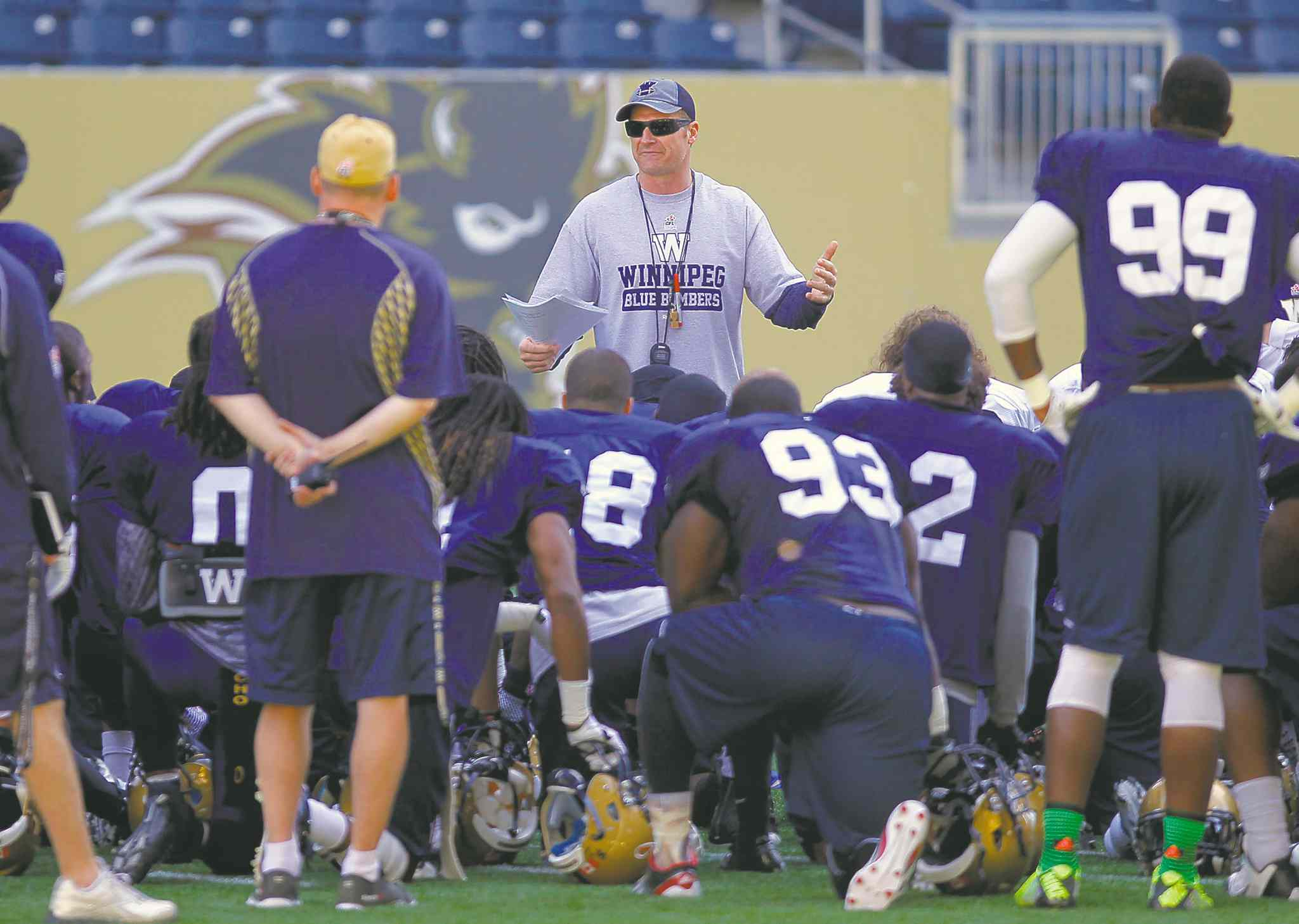 Winnipeg Blue Bombers coach Mike O'Shea talks to the team after the first half of today's practicee at the Investers Group Field. BORIS MINKEVICH / WINNIPEG FREE PRESS  June 3, 2014