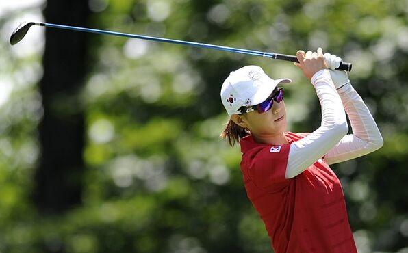 Na Yeon Choi, of South Korea, tees off the fifth hole during the final round of the International Crown golf tournament Sunday, July 27, 2014, in Owings Mills, Md. (AP Photo/Gail Burton)