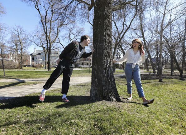 Riva Billows and Isaac Tate hang out in Enderton Park. The couple are keeping their families safe by social distancing their relationship — a change that Billows says has actually brought them closer together.</p>