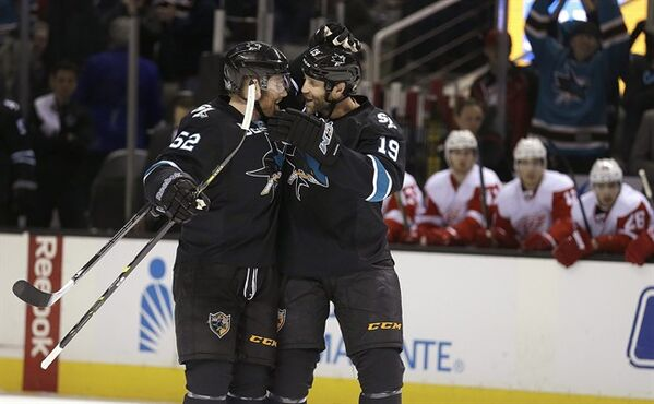 San Jose Sharks' Matt Irwin, left, is congratulated by Joe Thornton (19) after Irwin scored against the Detroit Red Wings during the first period of an NHL hockey game Thursday, Feb. 26, 2015, in San Jose, Calif. (AP Photo/Ben Margot)