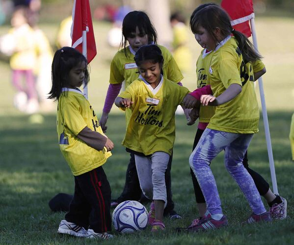 Supanpreet Chohon, centre, takes part in a soccer program that encourages participation by inner-city girls Tuesday, May 19, 2015. John Woods / Winnipeg Free Press - Winnipeg Free Press