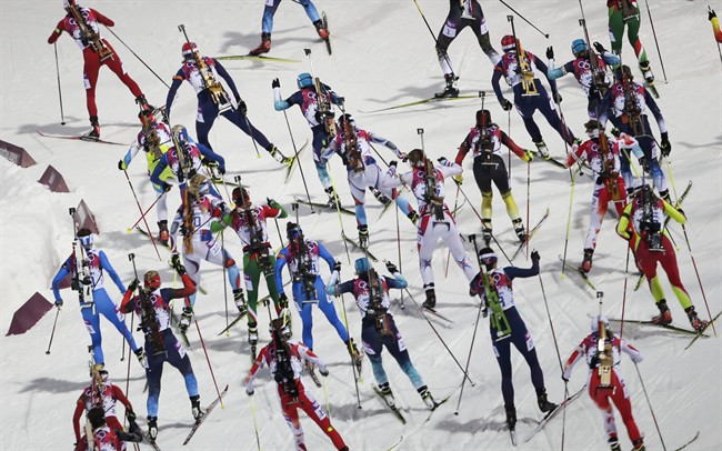 The athletes starts for the women's biathlon 12.5k mass-start, at the 2014 Winter Olympics, Monday, Feb. 17, 2014, in Krasnaya Polyana, Russia. (AP Photo/Gero Breloer)
