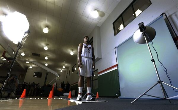 Milwaukee Bucks' Jabari Parker poses for a picture during the team's media day Monday, Sept. 29, 2014, in St. Francis, Wis. (AP Photo/Morry Gash)