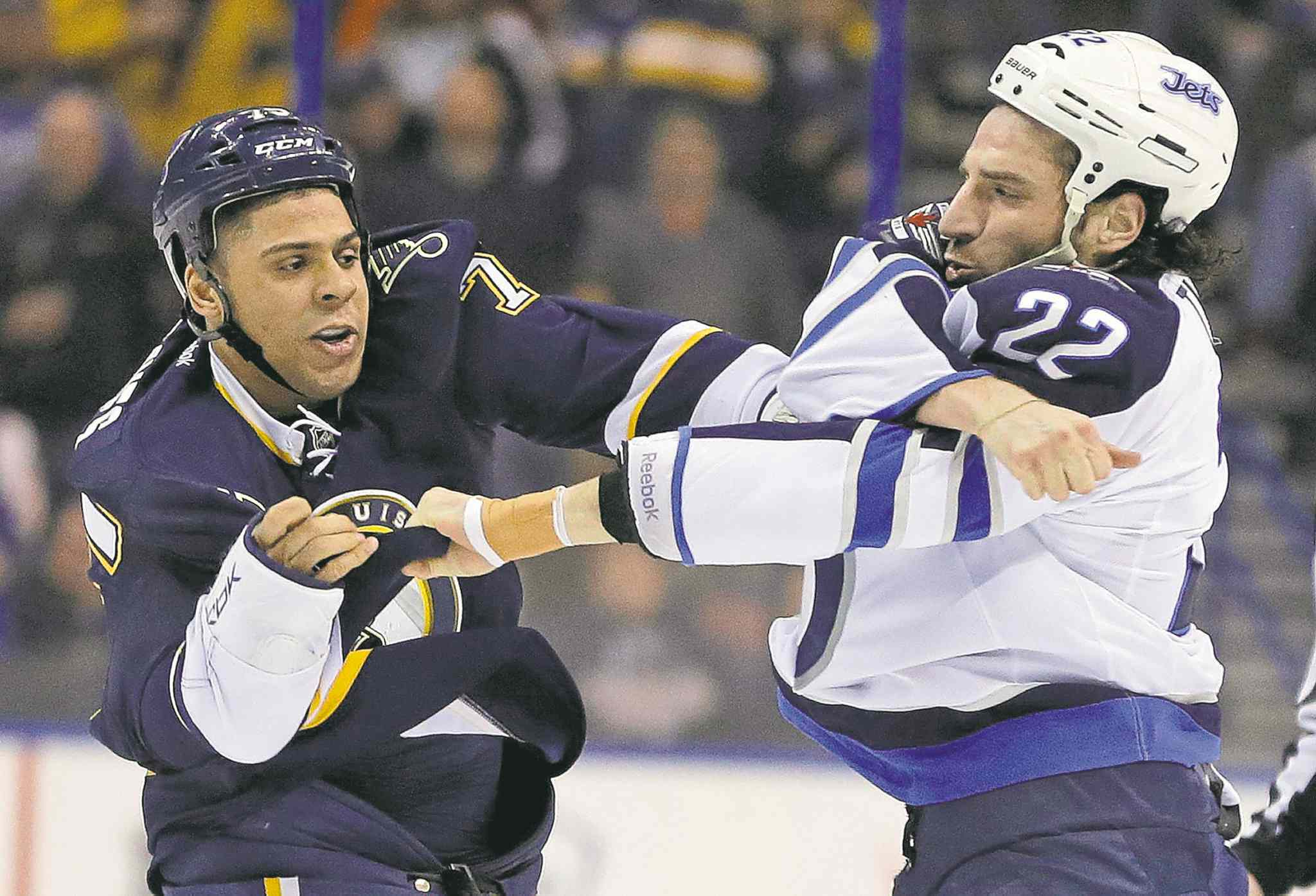 Winnipeg Jets' Chris Thorburn (right) dukes it with St. Louis Blues' Ryan Reaves last season.