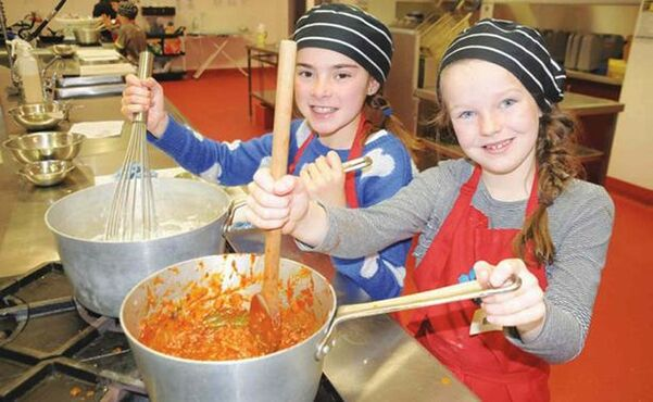 Two girls take part in the Kids in the Kitchen program served up by the Macdonald-Headingley Recreation District.