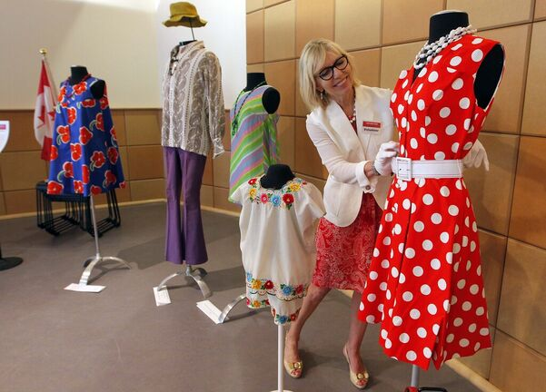 The Costume Museum of Canada remains closed and had to cancel a planned Manitoba 150 event and a historic fashion revue. Above, Andrea Brown puts the finishing touches on a past exhibit, A Day in the Life 150 Years of Canadian Apparel. (Boris Minkevich / Winnipeg Free Press files)
