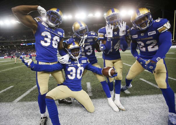 Mercy Maston (from left), Winston Rose, Anthony Gaitor, Marcus Sayles and Chandler Fenner celebrate an interception against Calgary in 2019. Maston is out for the season after tearing his right Achilles on Sunday. (John Woods / The Canadian Press files)</p>