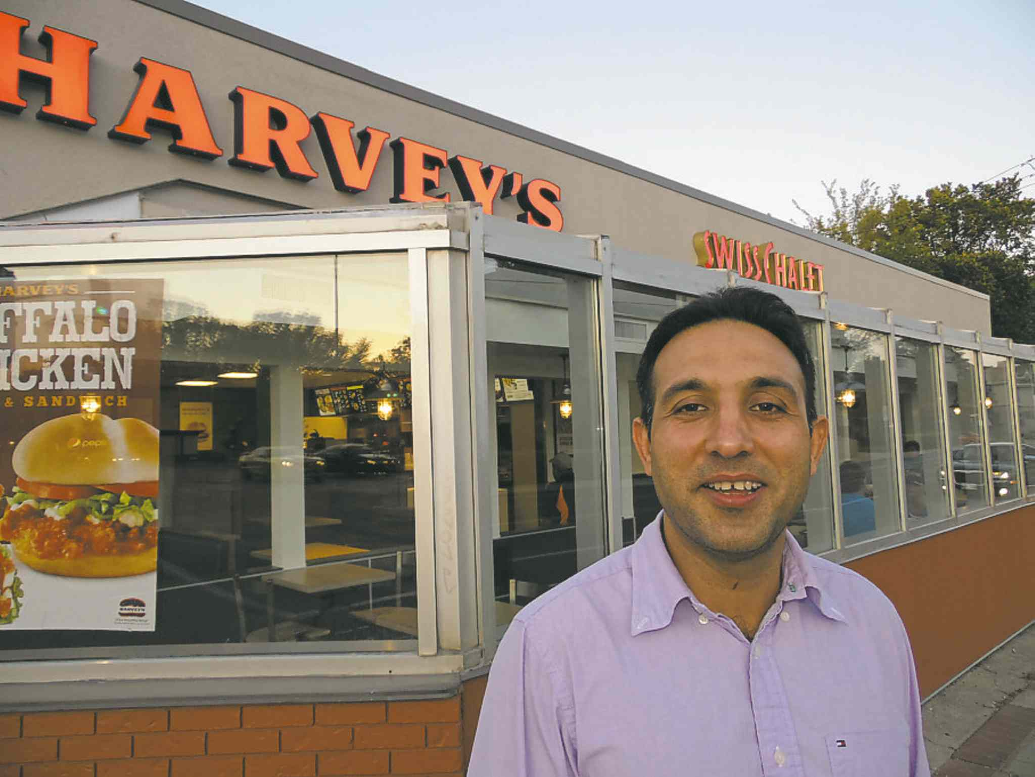 Sartaj Singh in front of his newly opened restaurant.