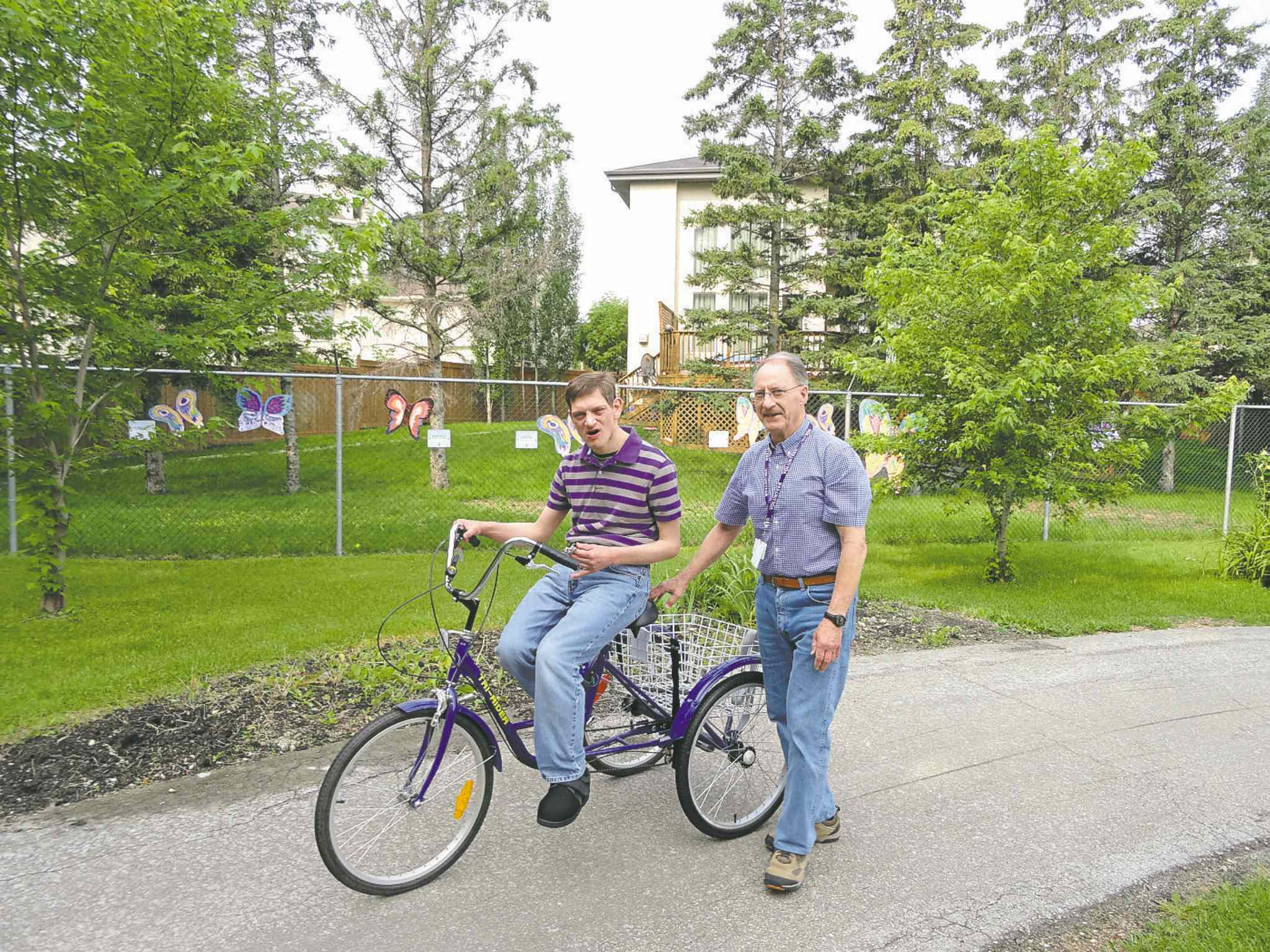 Chris Schiffmann / Winnipeg Free PressJack Froese, with friend Teddy Siwik on a bike, is St. Amant�s Volunteer of the Year.