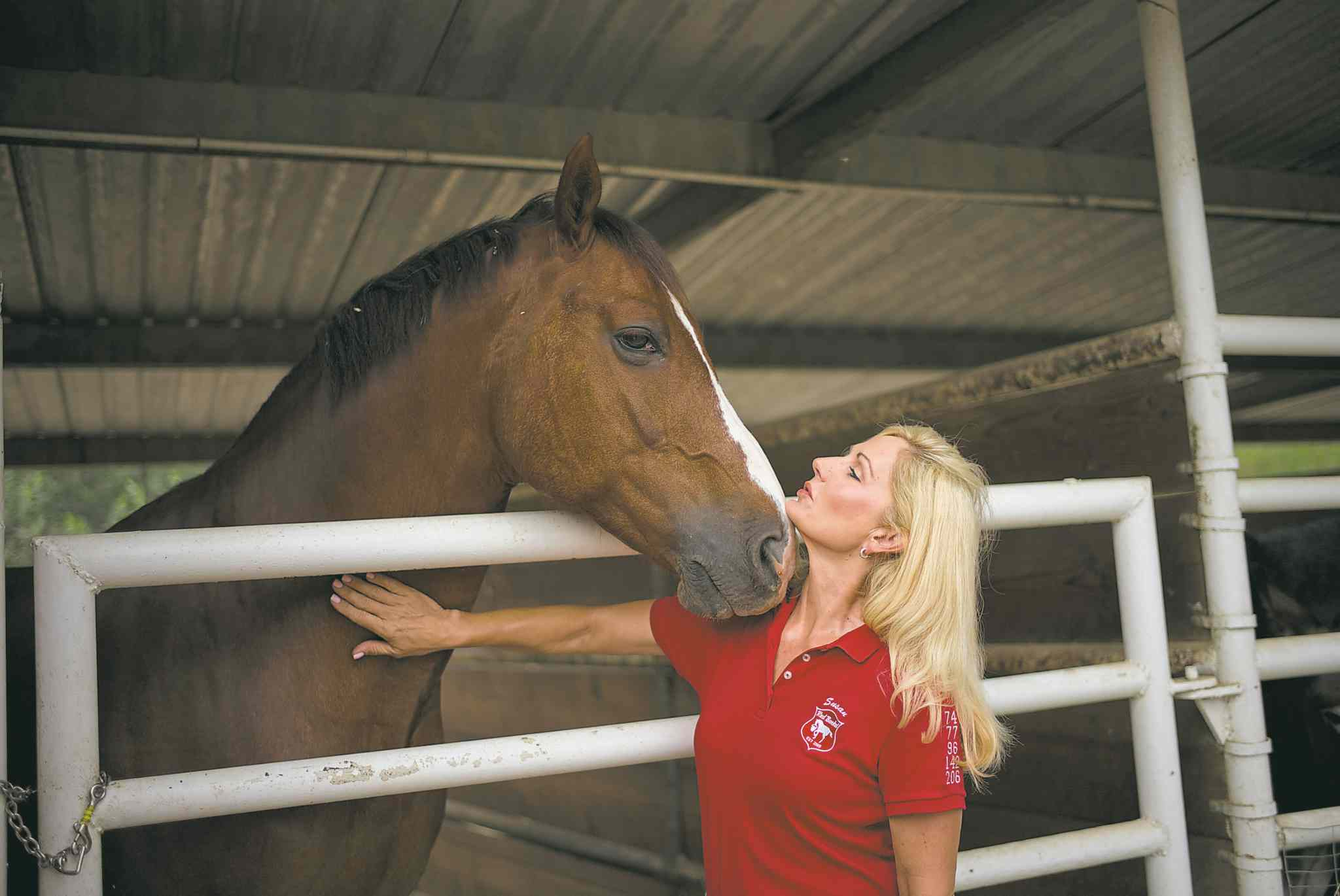 Red Bucket Equine Rescue founder Susan Peirce bonds with one of her rescued horses.