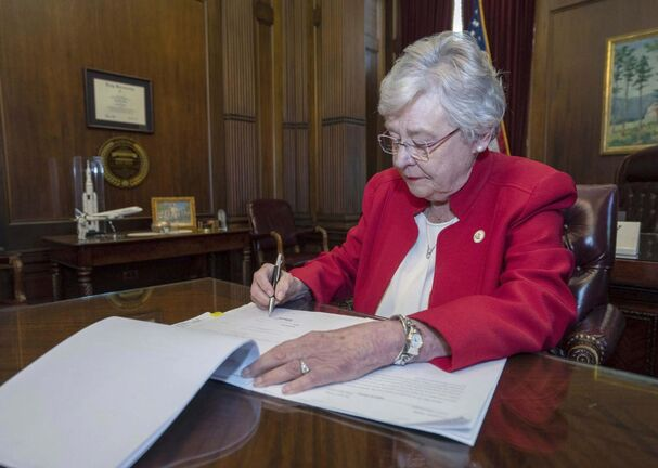 Alabama Gov. Kay Ivey signs the state's abortion bill. (Hal Yeager / Alabama Governor's Office)