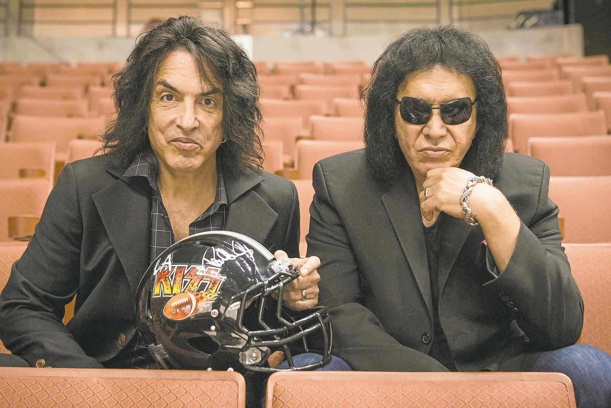 Paul Stanley, left, and Gene Simmons trade guitars for the gridiron on reality series 4th and Loud.