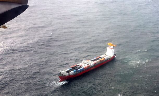 A Royal Canadian Air Force helicopter flies near a drifting Russian container ship off British Columbia's northern coast on Friday Oct. 17, 2014. THE CANADIAN PRESS/HO, DND-Maritime Forces Pacific