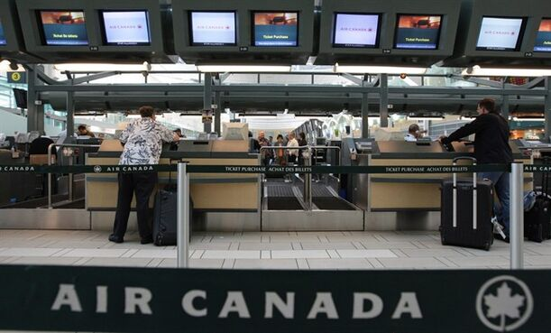 Air Canada passengers check in at the Vancouver International Airport on June 17, 2008. THE CANADIAN PRESS/Darryl Dyck