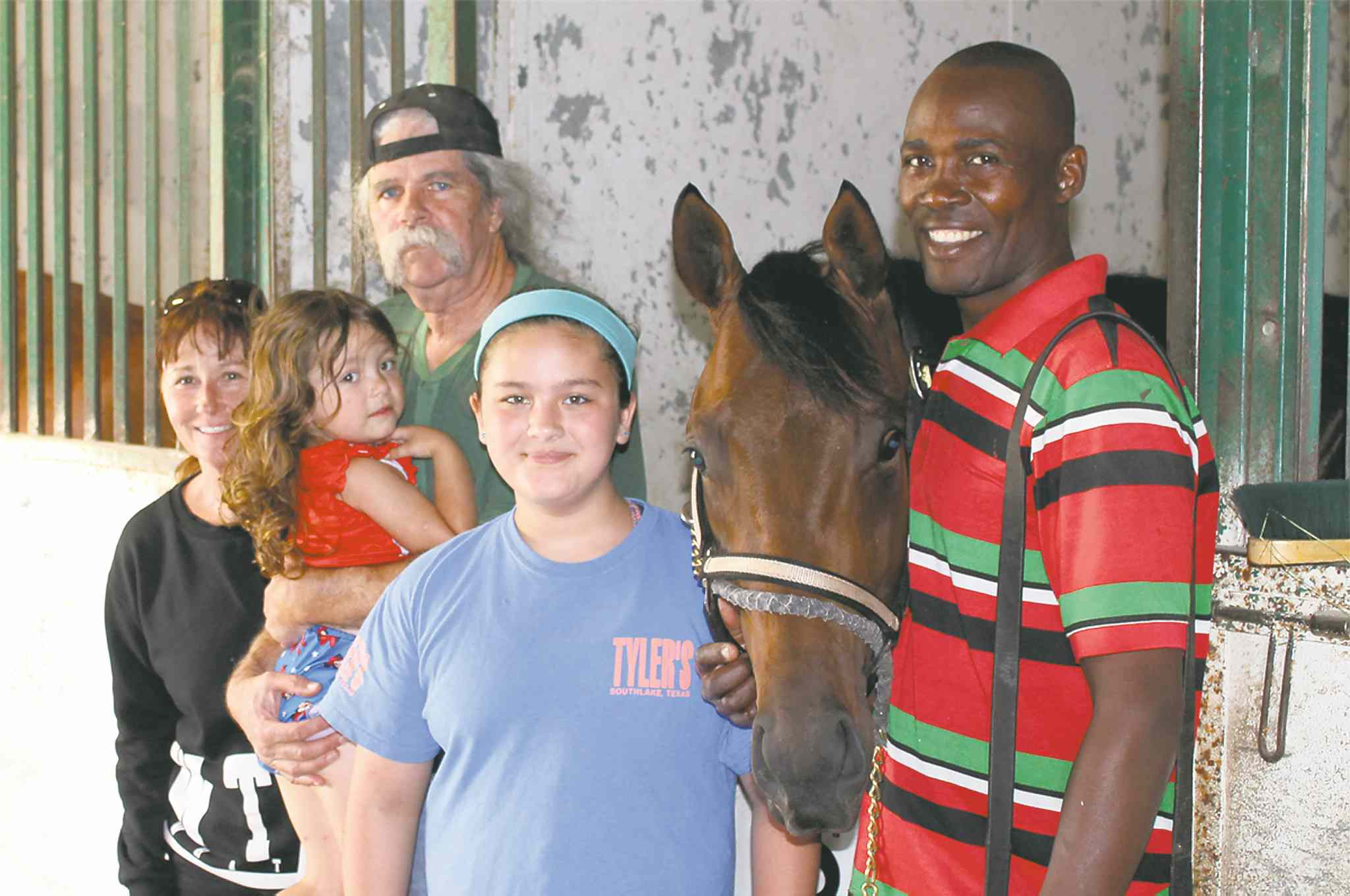 Left to right: owner Terry Propps, Lola, trainer Charlie Smith, Maddy, and groom Vaughan Taylor with Graduation Stakes winner Spider's Alibi.