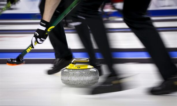 A rock makes its way down the sheet during hot shots competition at the Brier in Calgary, Alta., Friday, Feb. 27, 2015. THE CANADIAN PRESS/Jeff McIntosh