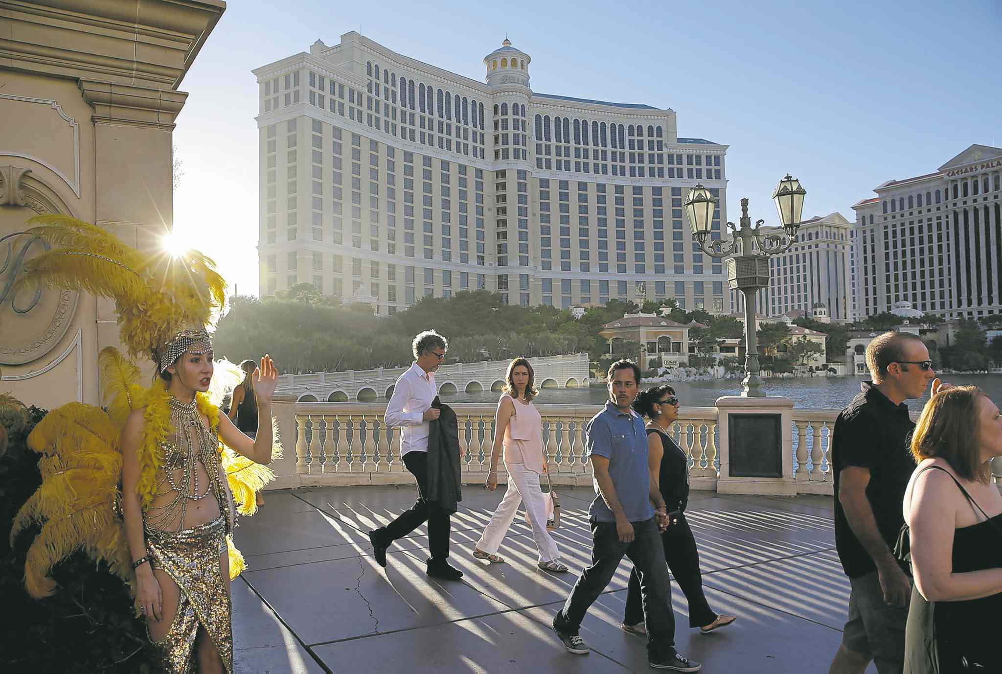 John Locher / The Associated PressPeople walk by the Bellagio hotel in Las Vegas. This year, hotels will take in a record $2.25 billion in revenue from fees and surcharges, six per cent more than last year and nearly double that of a decade ago.